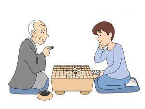 囲碁を楽しむおじいさんと孫
